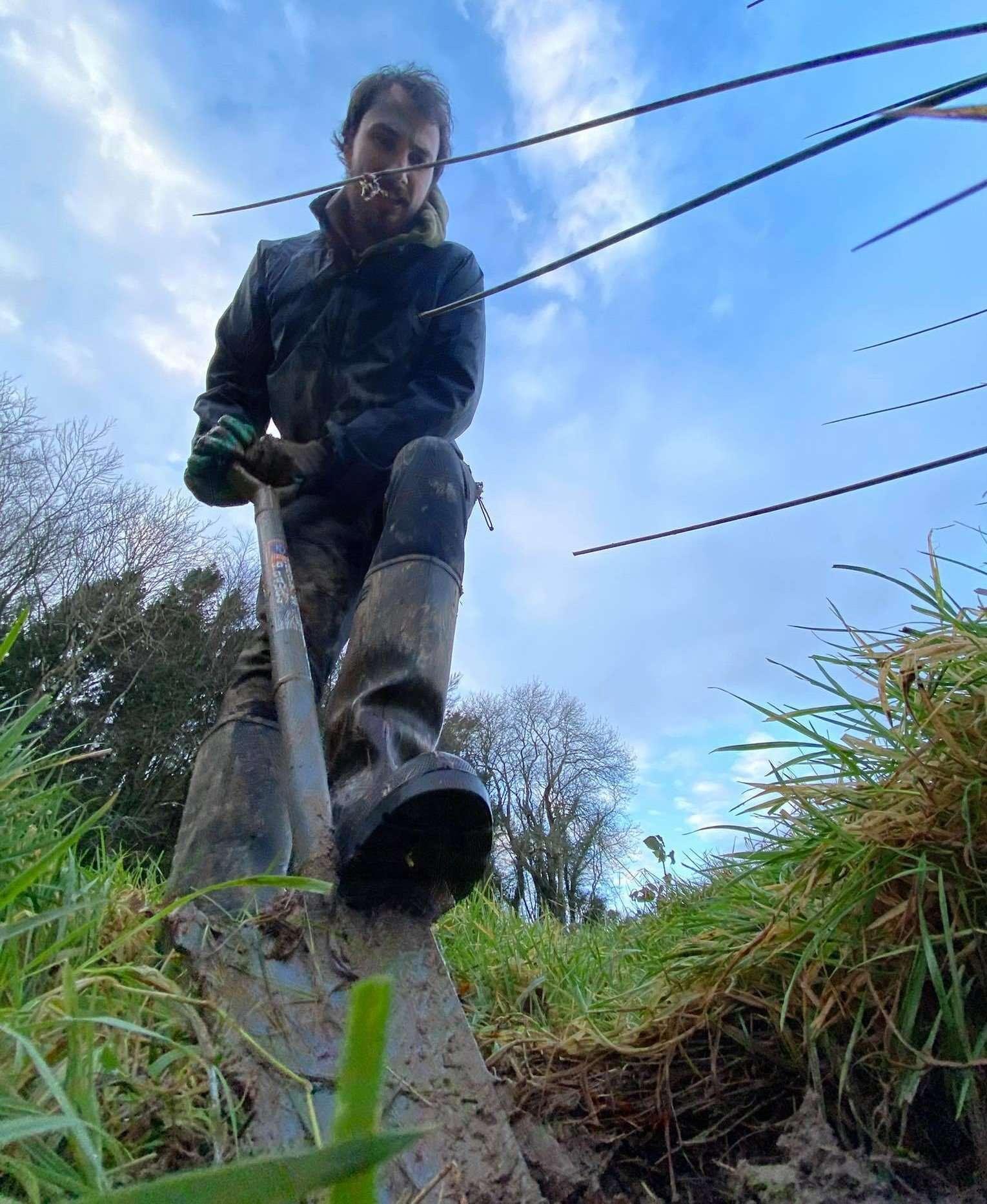 Shovel to ground SRI staff Planting native Trees in Ireland